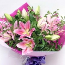 pink-lilies-in-a-hand-tied-bouquet